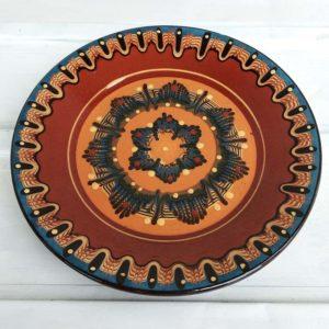 Grande assiette peinte en bleu et marron